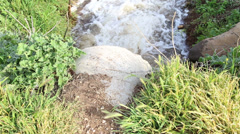 Stock Video Footage of water flowing in an irrigation canal