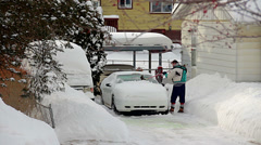 Stock Video Footage of Neighbor cleaning winter snow off car
