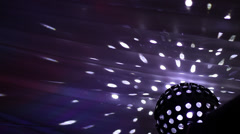 Dance Ball - rotating globe light against a white tent Stock Footage