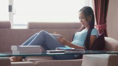 2of22 Asian girl at home with computer, phone and book - stock footage