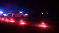 Police cars and flares blocking road Stock Footage