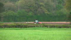 Farming Agriculture Tractor Ploughing Green Field Landscape Stock Footage