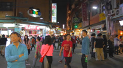 Many people walking through the fenjia night market in taichung 3 Stock Footage