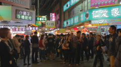 Many people walking through the fenjia night market in taichung 2 Stock Footage