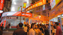 Many people waiting at fenjia night market entrance Stock Footage