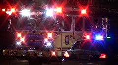 Police car and ladder truck Stock Footage