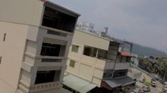 Birds eye tilt shot at the town of ita thao Stock Footage