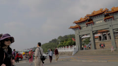 Pan across the street at wen wu temple 2 Stock Footage