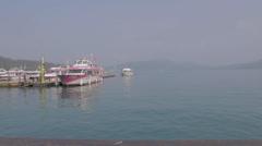 Dolly shot - boats at the sun moon lake pier Stock Footage