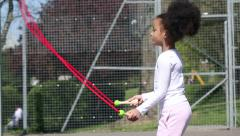 Young child skipping with a jump rope outdoors Stock Footage