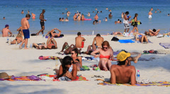 Girls and boys sunbathing on the beach and in the sea. Island Phangan, Thailand Stock Footage