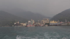 View of town of ita thao as boat leaves golden hour 2 Stock Footage