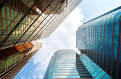 Mirrored office building exterior, Hong Kong - stock photo