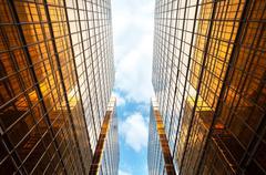 Upwards perspective of symmetrical contemporary skyscrapers Stock Photos