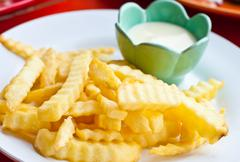 french fries with mayonnaise on white plate - stock photo