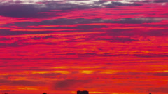 Fiery red sunset over Los Angeles cityscape skyline. Timelapse. Stock Footage