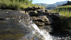 Environment. stream of clear water flowing ceaselessly Stock Footage