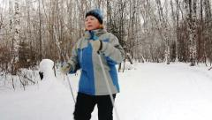 Nordic Walking adult woman in winter park. Stock Footage
