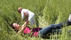 Woman with baby in the grass Stock Footage