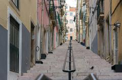 narrow alfama streets and stairs, lisbon - stock photo