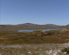 NORWAY vehicle shot lichen and heather covered tundra landscape with small lake Stock Footage