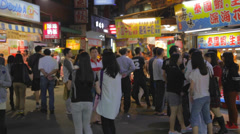 Many people at fenjia night market in taichung Stock Footage