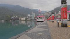 Dolly shot emerald lake boat at ita thao pier Stock Footage