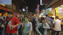 Many people at fenjia night market in taichung 2 Stock Footage