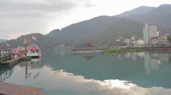 Wide shot of the pagoda at sun moon lake Stock Footage