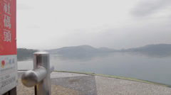 Dolly shot of sun moon lake at edge of pier Stock Footage