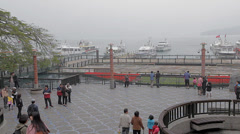 People walk at shueshe pier Stock Footage