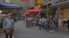 People walk on side street near shueshe pier Stock Footage