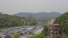 Wide shot of buses and shueshe pier Stock Footage