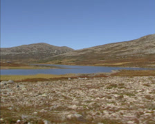 RONDANE, NORWAY vehicle shot lichen and heather covered tundra landscape Stock Footage