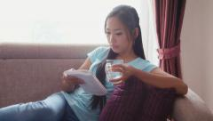 8of22 Asian girl at home with computer, phone and book Stock Footage