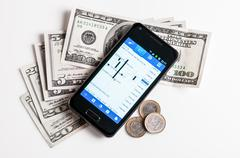 Forex trading by mobile phone Stock Photos