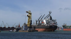 Bulk handling, reload dry bulk from seagoing ship to barge for inland waterways Stock Footage