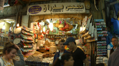 Tourists visit bazaar market street old city Jerusalem Stock Footage