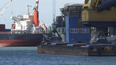 WAALHAVEN bulk handling - reload dry bulk from seagoing ship to barge Stock Footage