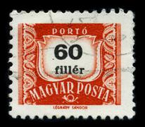 Old postage stamp on a black background. Stock Photos