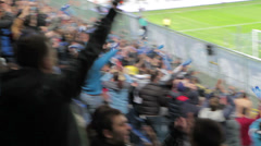 Football fans on the city stadium during the match Dnipro - Volyn Stock Footage