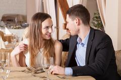 couple flirting in restaurant - stock photo