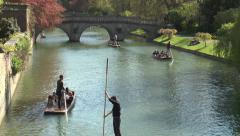 Cambridge punting: tour guides in action near Clare College bridge Stock Footage
