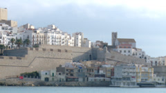Church and houses waterfront old town Stock Footage