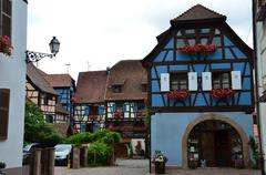 Street with half-timbered medieval houses in eguisheim Stock Photos