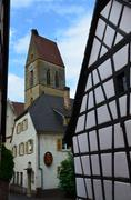 Stock Photo of street with half-timbered medieval houses in eguisheim village