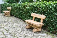 paved street with wooden benches, etara, bulgaria - stock photo