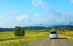 minibus on the country highway - stock photo