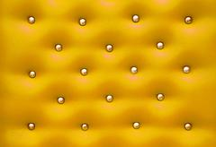 Golden leather pattern with knobs,texture for background Stock Photos