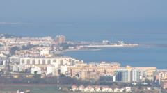 Seaside port town in the distance from the mountain Stock Footage